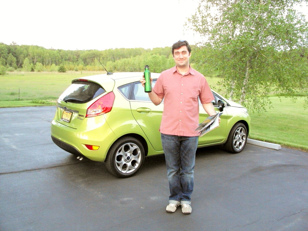 Picture of Sean McBride in front of his Ford Fiesta with matching water bottle